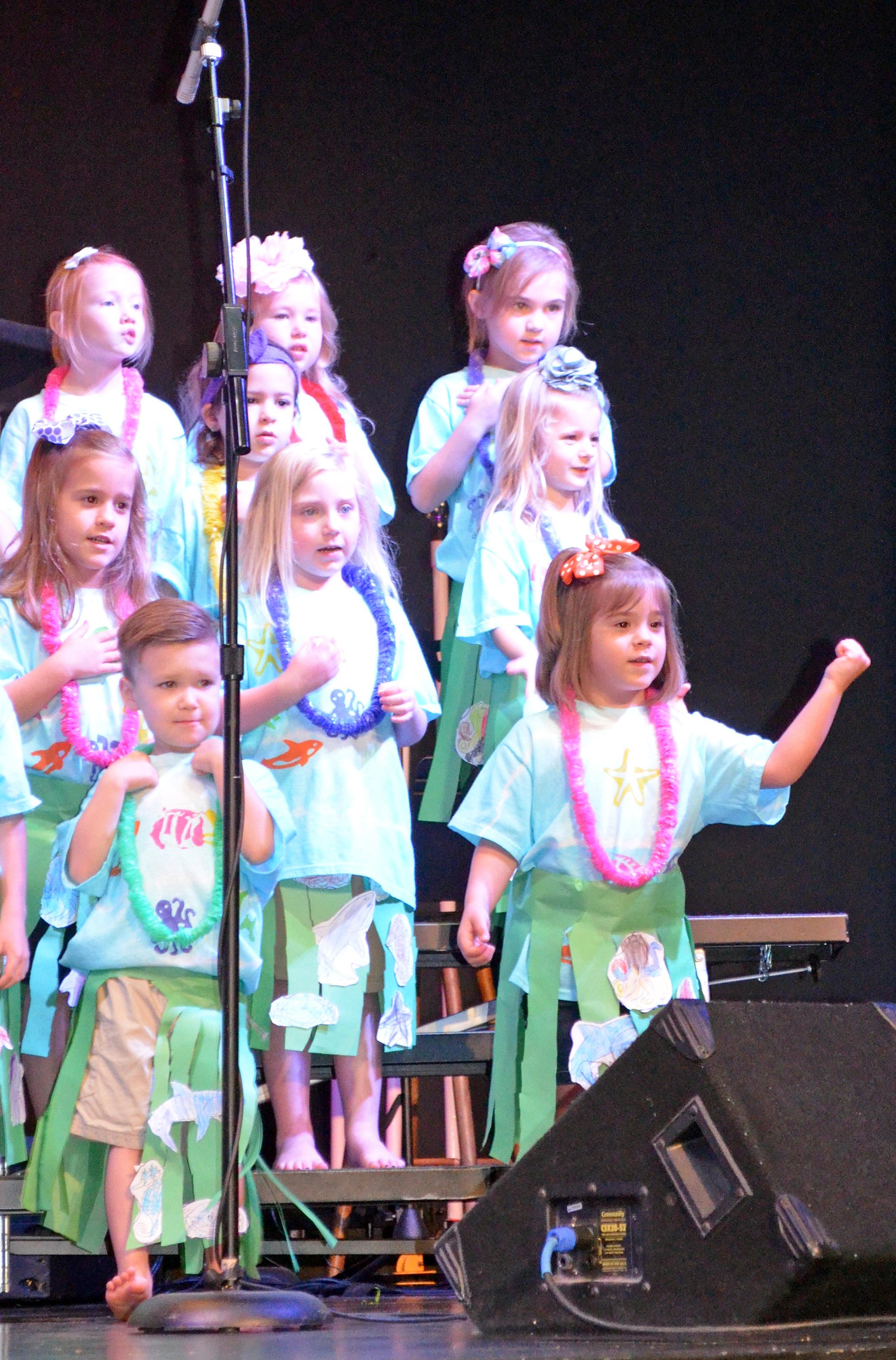 Rejoice christian preschool students perform in luau for Acapulco golden tans salon owasso ok