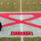 Pink Ribbon for Breast Cancer Awareness Painted on Ator Field to Support FOR Football and Cheer Campaign